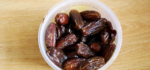 A plastic container of sweetened dates