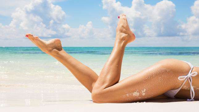 Hair removal - legs on a beach